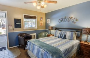 Queen Bed with Teal Throw Blanket