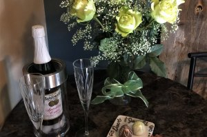 Wine, chocolate, and white roses