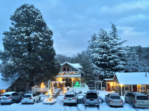 Front view of Prescott Pines Inn in the Snow