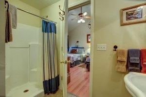 View of beds through bathroom doorway