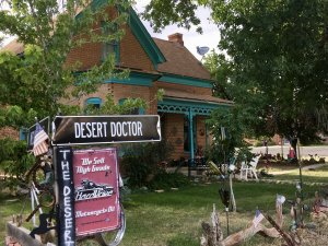 House with sign reading Desert Doctor