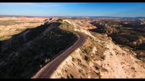 A road winding along a narrow ridgeline