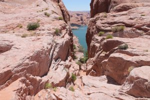 View of a lake through a narrow canyon