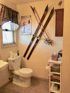Bathroom with antique skiis on the wall