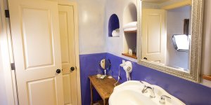 A bathroom with purple themed walls