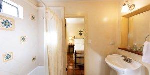 A bathroom adjacent to a bedroom
