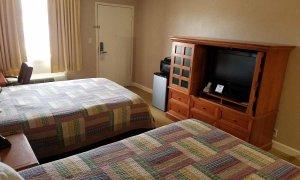 Beds and TV in Double Queen Deluxe