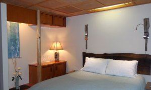 Bed with bedside lamp
