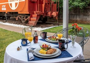 Breakfast by the red caboose