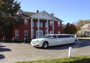 White limo outside The Woodrow House