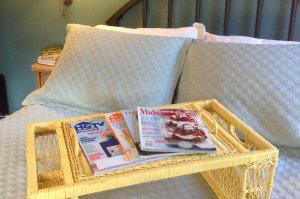 Breakfast in bed service tray with magazines