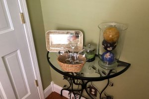 End table full of curiosities
