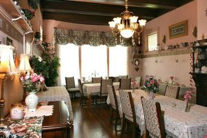 a dining room with floral arrangements on the tables