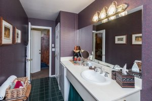 bathroom sink with purple wallpaper  | The Inn at 410, Downtown Flagstaff, AZ