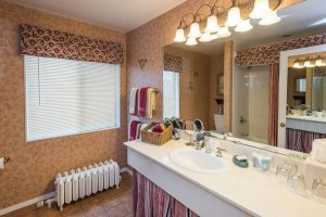 bathroom sink and mirror | The Inn at 410, within driving distance of Grand Canyon