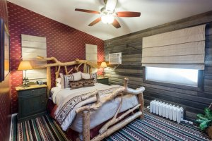 Western themed bedroom with log bed | The Inn at 410, within driving distance of Grand Canyon