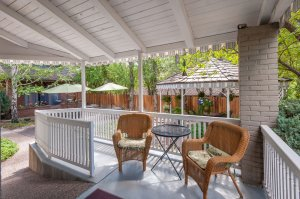 Backyard porch and wicker chairs | The Inn at 410, Flagstaff, AZ