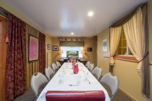 Long meeting table in curtained room | The Inn at 410, Downtown Flagstaff, AZ