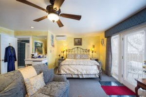 bedroom with sofa and glass doors | The Inn at 410, Downtown Flagstaff, AZ