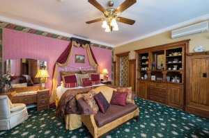 Bedroom with loveseat and vanity | The Inn at 410, near Sedona, AZ
