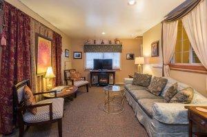 sitting area with TV and curtains | The Inn at 410, near Sedona, AZ