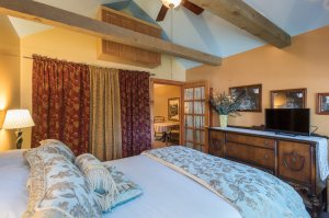 Bed with TV and glass door | The Inn at 410, near Sedona, AZ
