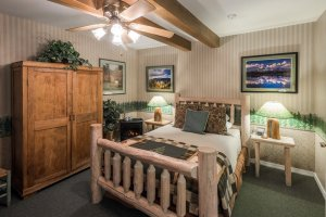 log bed and armoire | The Inn at 410, near Sedona, AZ