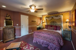 bed with ornate bedframe | The Inn at 410, near Sedona, AZ