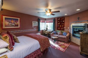 bedroom with bed and sofa | The Inn at 410, near Sedona, AZ