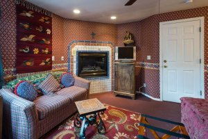 Ornate coffee table, fireplace, and TV | The Inn at 410, near Sedona, AZ
