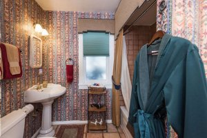sink and shower with native american wallpaper | The Inn at 410, near Sedona, AZ