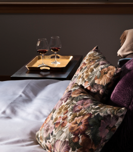 Pillows with Wine on table