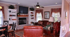 Sitting area with fireplace and television