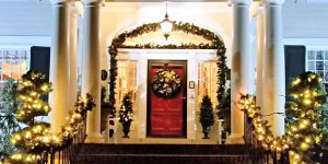 Porch decorated with garlands and Christmas lights