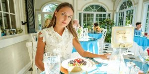 Girl with a plate of food