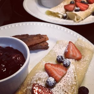 Rolled crepes with various berries