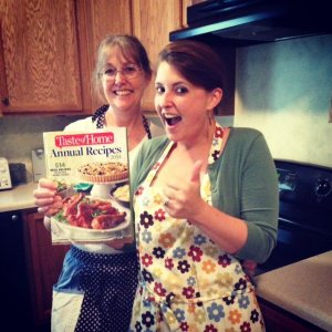Two excited women holding a recipe book
