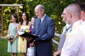 A man reading wedding vows