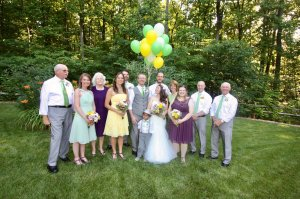 A bride and groom surrounded by their families