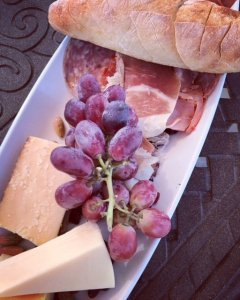 Grapes, cheese, sliced meat, and bread