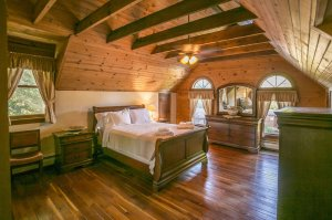 Bedroom with wood floor and exposed beams