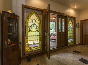 Wood door with stained glass