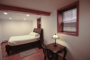 Queen bed and writing desk