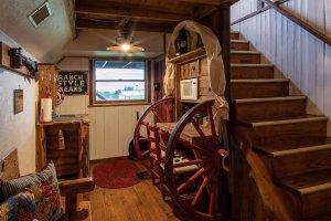 A counter set between wagon wheels