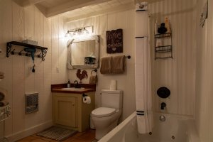 A bathroom with farm decor