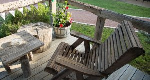 A wooden chair on a low deck