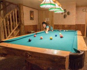 Woman playing pool