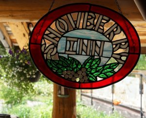 A stained-glass sign reading Snowberry Inn