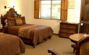 Two beds near a window