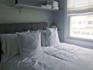 A bed near a window